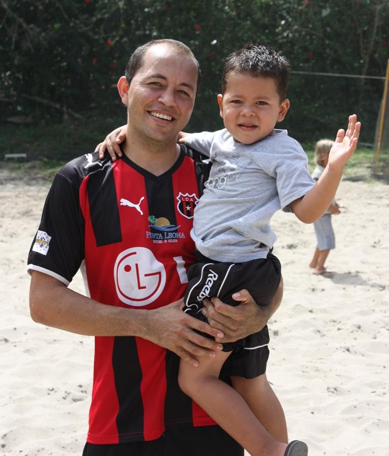 Punta Leona's Renato Segura celebrates with his son, Brithon, after the match